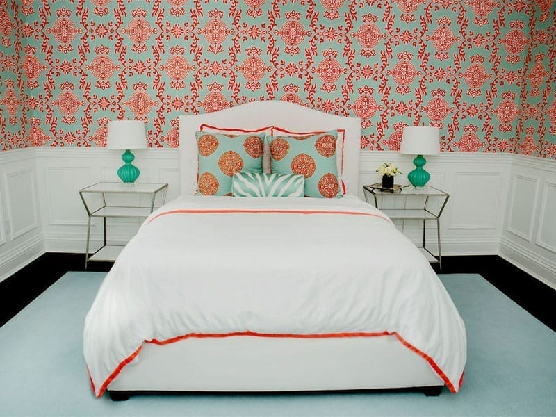 bedroom with printed pillows and wallpaper