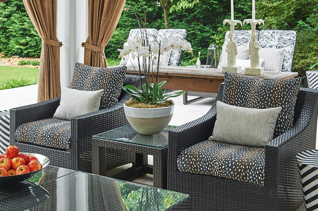 outdoor chairs with gray pillows