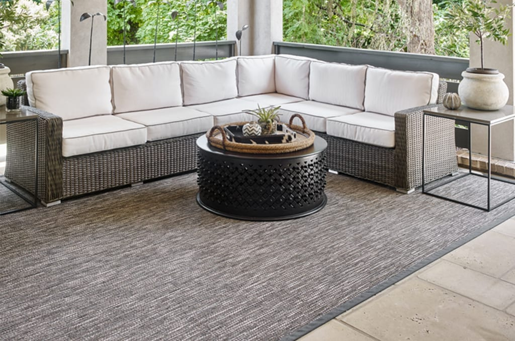 outdoor seating area with gray rug