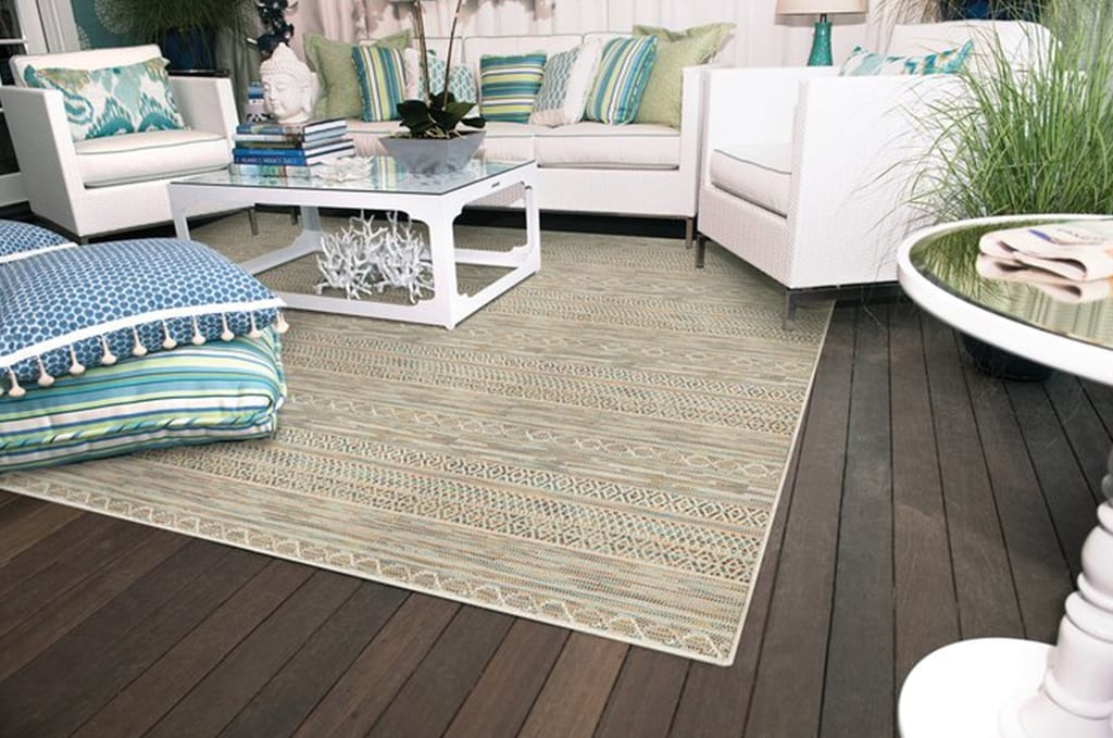 outdoor seating area with tan rug